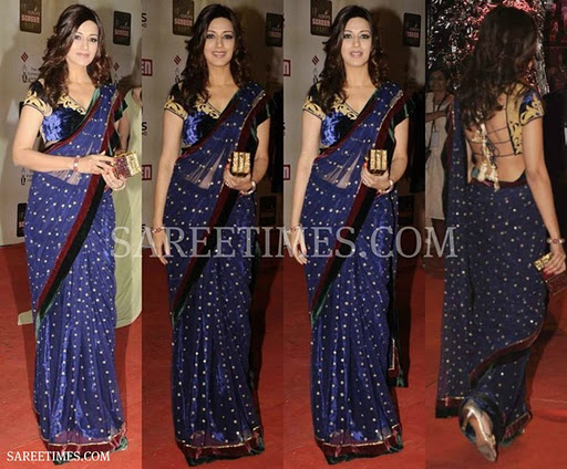 blue designer shimmer faux saree with polka dots and double border work  paired with designer embroidered short sleeves saree blouse for back at Screen Awards 2012
