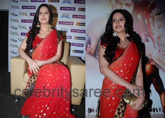 Zarine Khan in a lovely orange georegtte saree